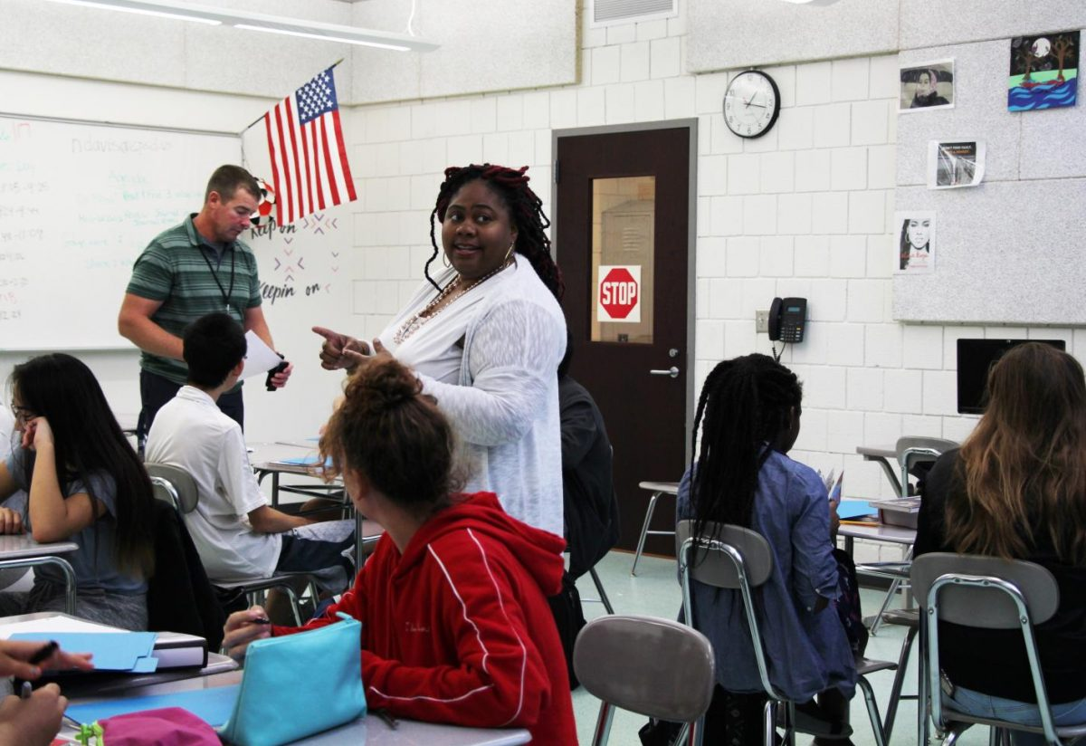 """Pictured: Ms. Bates and Mr. Davis co-teaching a """"leveled up"""" English class."""