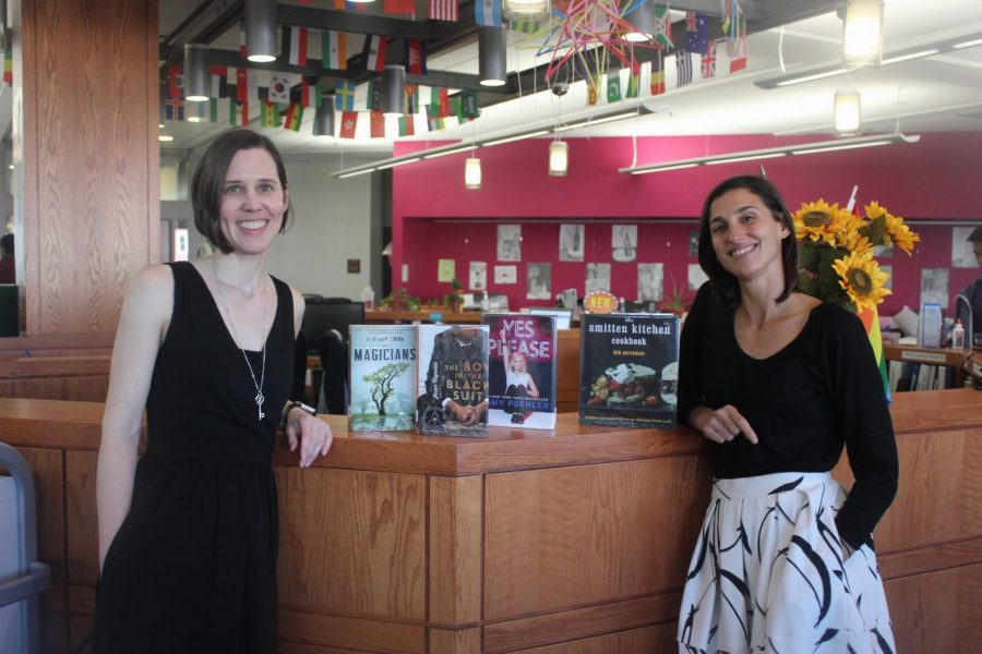 Pictured: Librarians Emily Houston (left) and Kendall Boninti (right) posing with some of their favorite books.