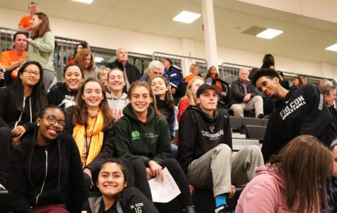 Pictured: Fans at an away girls volleyball game this past fall.