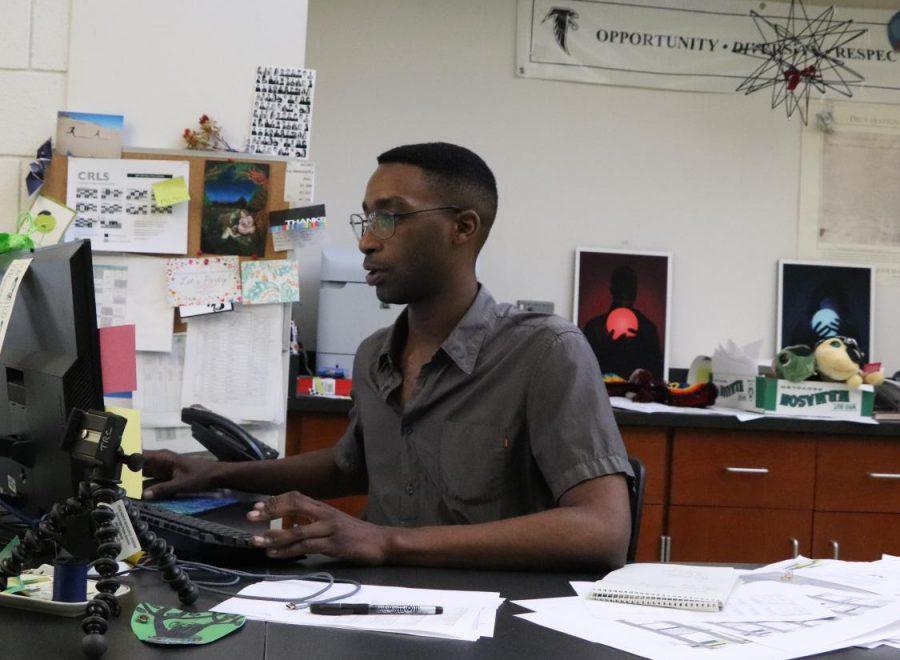 Pictured: Clerk Berhan Duncan working at his desk in LC R.