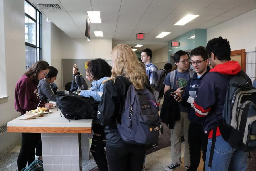 Pictured: Seniors buying prom tickets at the bagel benches during lunch.