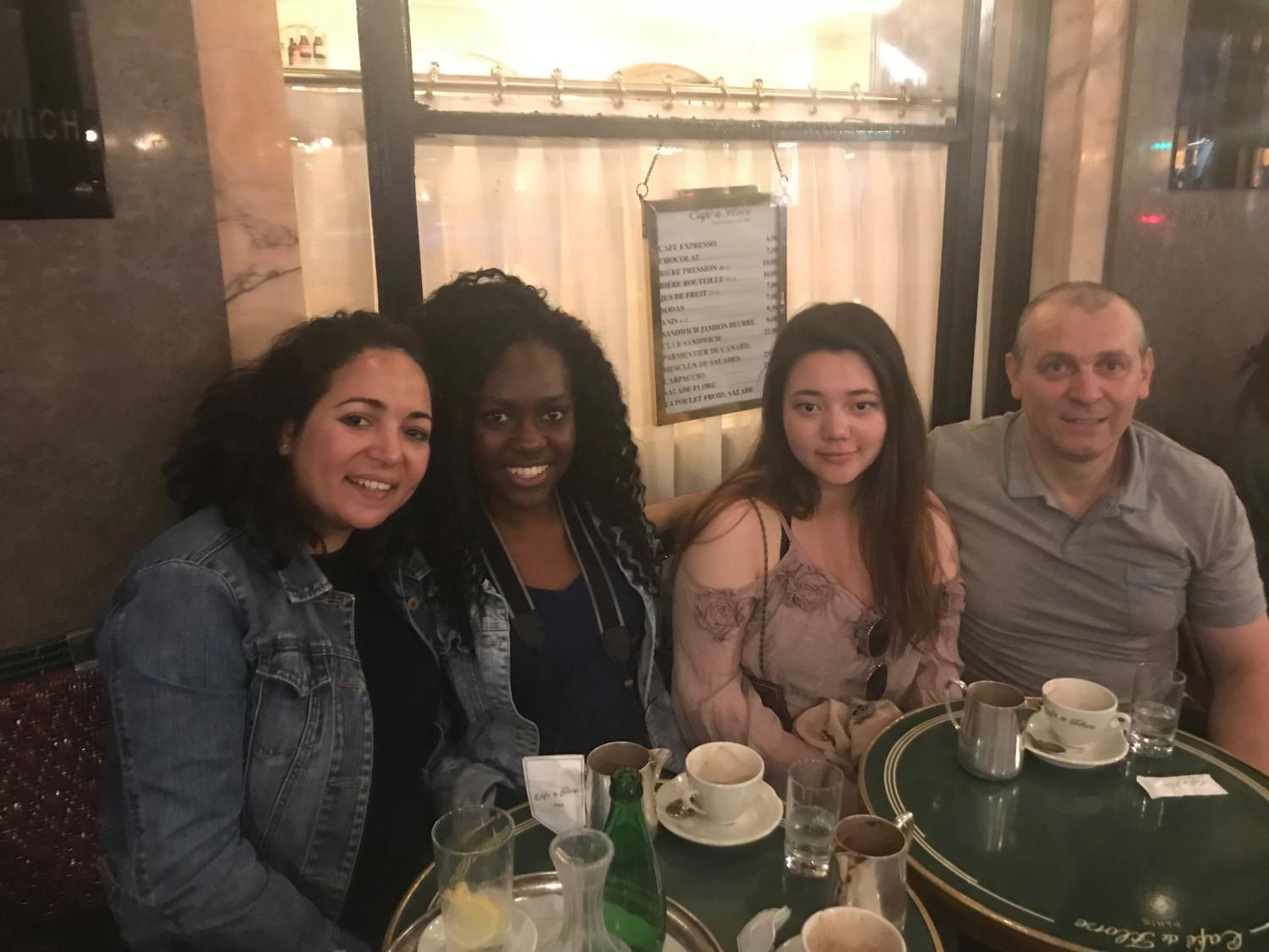 Pictured: Mayila Deus '19 with her host family in Paris.
