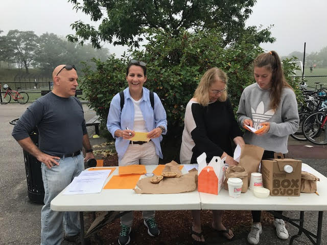 Students and parents volunteer at FOCA's City Run to help raise money for teams.