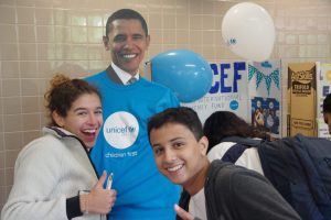 Pictured: Unicef members posing with a Barack Obama cutout.