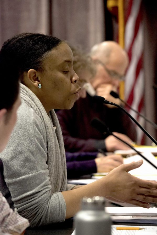 Pictured: School Committee member Manikka Bowman, proposing an independent investigation on the issue.