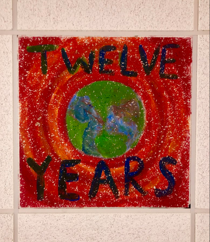 """The ceiling tiles, a part of the """"Love Your Planet"""" project, involved 46 students."""