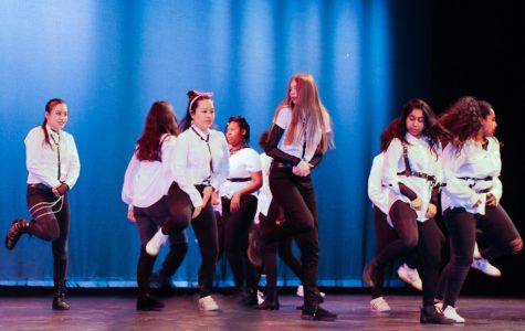 Pictured: CRLS' K-Pop Club dancing on stage for the Talent Show.