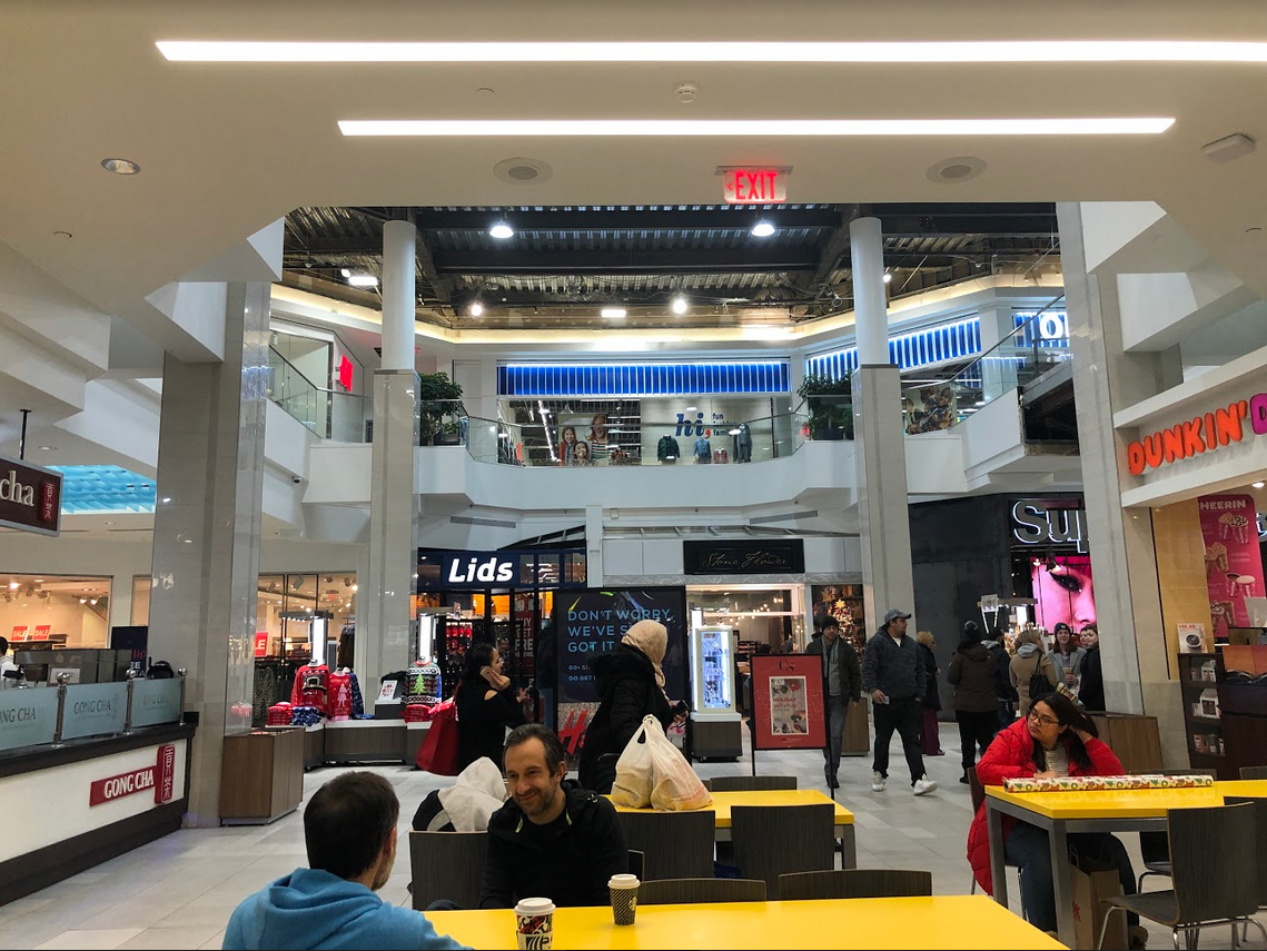 Pictured: Shoppers at the CambridgeSide mall in Cambridge.