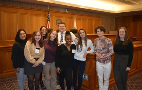 Pictured: Ms. Cesario and the group of CRLS students who attended the competition at Suffolk Law School.