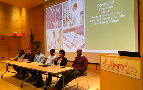 Pictured: Amgen panelists speaking at the Cambridge Public Library's main branch.