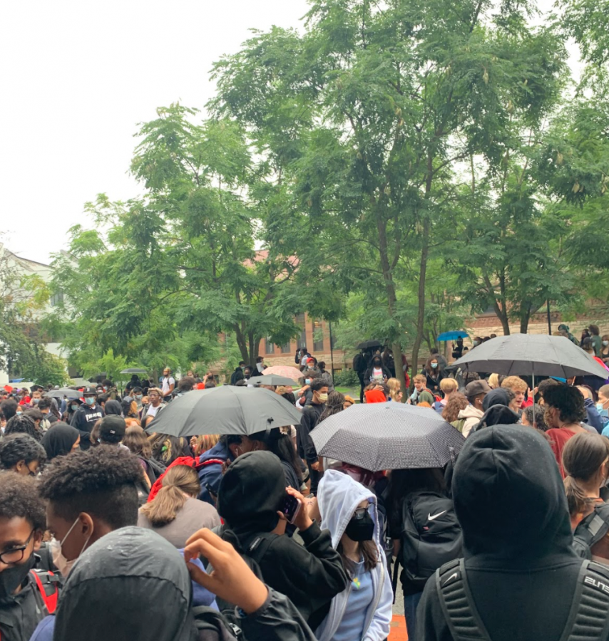 Students gather outside the main entrance after school.